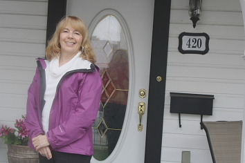 Lorraine Moodie enjoys the porch of the Cleary House. Photo by RIchard Amery