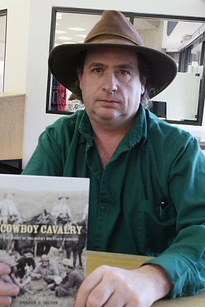 "Gord Tolton with a copy of his book ""The Cowboy Calvary: The Story of the Rocky Mountain Rangers."" Photo by Richard Amery"
