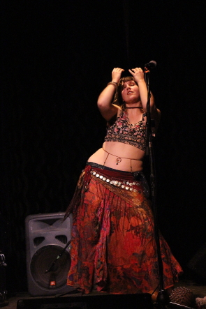 Belly dancer Maddy Young at the Slice, Nov. 28. Photo by Richard Amery