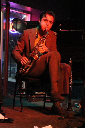 Billy Joe Abbott blowing a saxophone solo with harpdog brown, Feb. 26 at the Slice. photo by Richard Amery