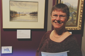 Wendy Aitkens indicates her favourite Edith Kirk work in the Galt Museum's new exhibit. Photo by Richard Amery
