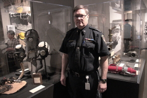 Jesse Kurtz and some of the artifacts he has used in the line of duty, on display in We Are Here To Serve: Fire and EMS. Photo by Richard Amery