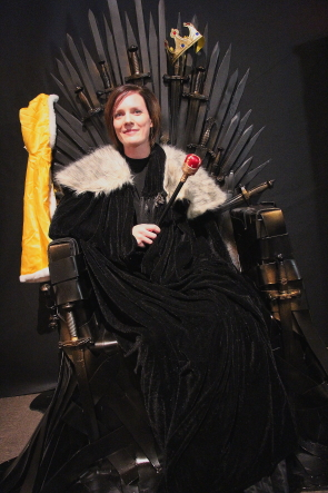 Aimee Benoit tries out the Game Of Thrones throne in the Worlds Imagined exhibit. Photo by Richard Amery