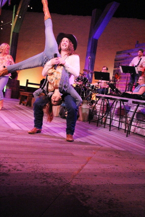 "Kyle Gruninger spins Kathy Zaborsky around during a version of Hank Williams Jr.'s ""All My Rowdy Friends are Coming Over Tonight"" during New West Theatre's presentation of Barn Dance, running Aug. 8-26 in the Yates Theatre. Photo by Richard Amery"