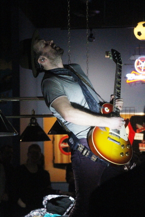 e Trews' John Angus MacDonald solos on top of a pool table at Average Joes, Feb. 5. Photo by Richard Amery