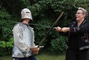 Juanita and Brent Devos do battle for the Windy Castle medieval Faire.Photos by Richard Amery